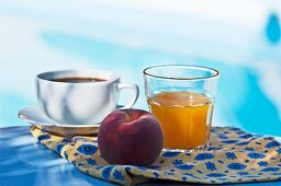 Coffee, orange juice and a peach for breakfast