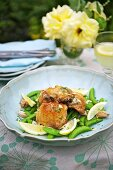Chicken with garlic, lemons and pea pods