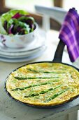 Asparagus omelette in a pan