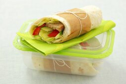 Tortilla wrap with minced meat, salad, pepper and cucumber