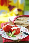 Stuffed tomatoes and flat bread