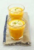 Cold carrot coup with surimi cream and lime