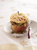 A baked apple with a pistachio-date filling and a dough lid