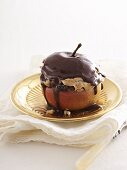 A baked apple with a gingerbread filling and a chocolate topping