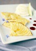 Apple tart with ice cream and raspberry puree