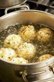Boiling Tyrolean bacon dumplings in water