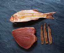 Anchovies, red mullet and tuna steak on granite