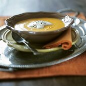 Pumpkin soup with cream and mixed pepper