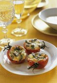 Baked tomatoes stuffed with pumpkin seeds and cheese