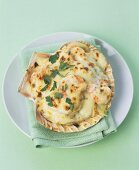 Seafood gratin with Parmeasn in a shell