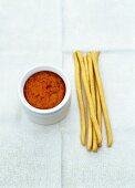 Grissini with red pepper and goat's cheese dip