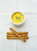 Curry quark dip with sesame sticks