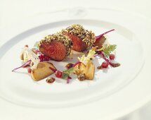 Venison medallions in nut crust with ceps