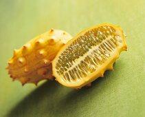 Whole kiwano and half a kiwano (horned melon)