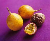 Whole golden passion fruits & whole & half purple passion fruit