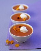 Cold red pepper soup with tequila, soft cheese, marigold petals