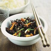 Sweet and sour mushrooms with sesame seeds