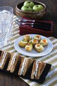 Salmon sandwiches and potatoes with salmon caviar