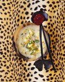 Potato soup with black pudding on cheetah skin