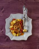 Braised shin of beef with potatoes and tomatoes