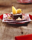 Chocolate brownie with poached pears