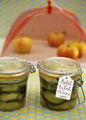 Minted apple relish in two preserving jars