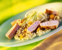 Barley risotto with physalis and fried salmon
