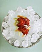 Salmon marinated in beetroot on ice