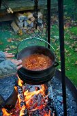 Rice stew hanging over a camp fire