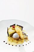 Apple mousse tartlet with Calvados jelly, apple ice cream and baked pralines