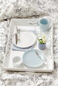 A breakfast tray with white tulips