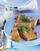 Breton galettes with pumpkin filling and cress