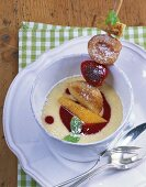 Fruit skewer on semolina pudding with raspberry sauce