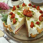 Strawberry cream cake, decorated with pastry geese
