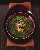 Miso soup with tuna and herbs