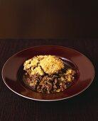 Minced beef under Parmesan crust