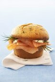 A muffin filled with salmon and dill