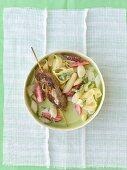 Lamb kebab on asparagus and strawberries