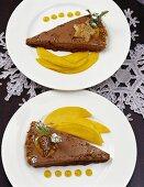 Chocolate parfait with nut brittle and fresh mango