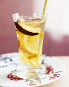Sake punch with plum and slices of citrus fruit