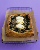 Mushroom & goat's cheese tart on a rack with baking parchment
