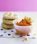 Red pepper hummus with small pita breads