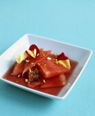 Watermelon in rosé wine with pistachios