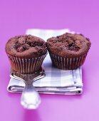 Two chocolate raspberry muffins