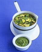 Vegetable soup with noodles and basil pesto