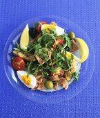Salade niçoise on a glass plate