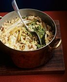 Barley risotto with bacon, beans, chicory and lemon pesto