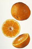 Three clementine halves against white background