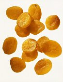 Dried apricots against white background