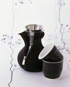 Black tea beakers and teapot in Neoprene jacket